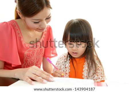 Mother with little girl studying. - stock photo