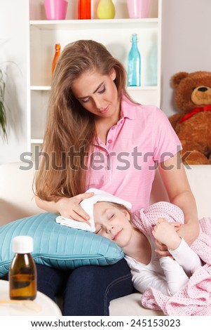 Mother with sick child - stock photo
