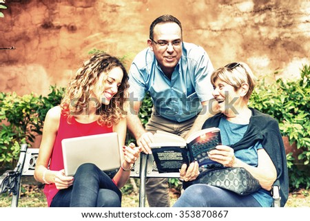 Mother with son and daughter relaxing and smiling on a bench outdoor. Family and happiness concept. - stock photo