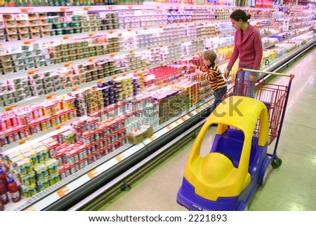mother with son in shop - stock photo