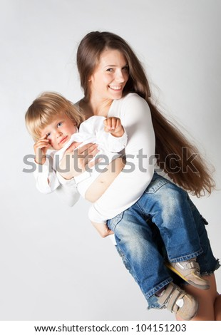 Mother with son in studio - stock photo