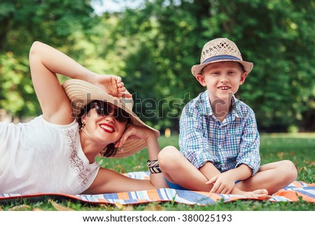 Mother with son on picnic in summer park - stock photo