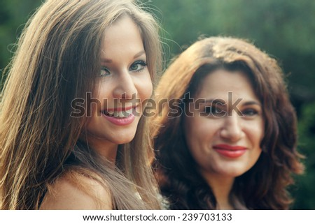 mother with teenage daughter - stock photo