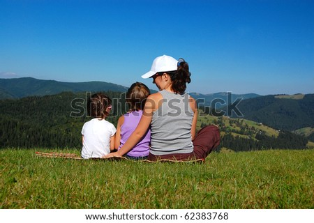 Mother with two kids looking at the beautiful view - stock photo