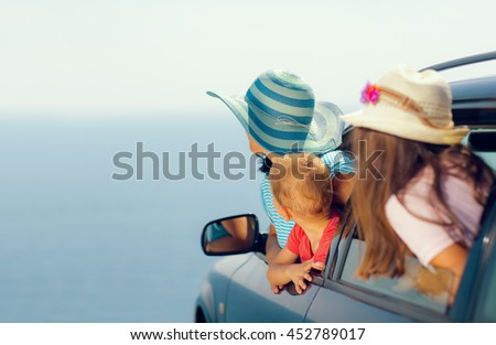 Mother with two kids travel by car on sea vacation, selective focus - stock photo