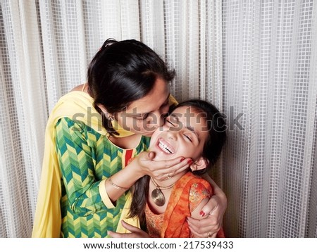 Motherhood- loving her daughter. - stock photo
