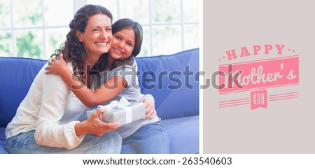 mothers day greeting against happy mother and daughter hugging and smiling at camera - stock photo