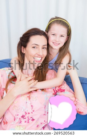 mothers day greeting against mother and daughter smiling at camera - stock photo
