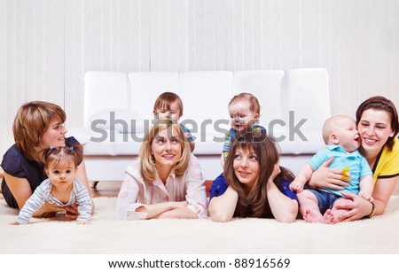 Mothers enjoying time with sweet babies - stock photo