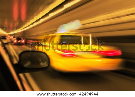 Motion and lens blurred taxi or cap in tunnel, Manhattan, New York - stock photo
