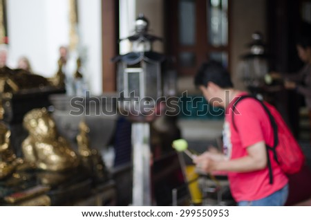 motion blur and blurry people praying at the temple - stock photo