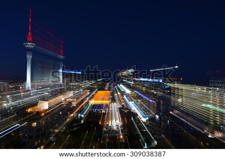 Motion blur background of Auckland financial center skyline at night in Auckland, New Zealand. - stock photo