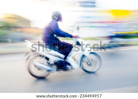 Motion blur background : red motorcycle running on road ,blurred background - stock photo