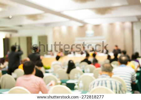 motion blur: de-focused Business Conference and Presentation. Audience at the conference hall. - stock photo