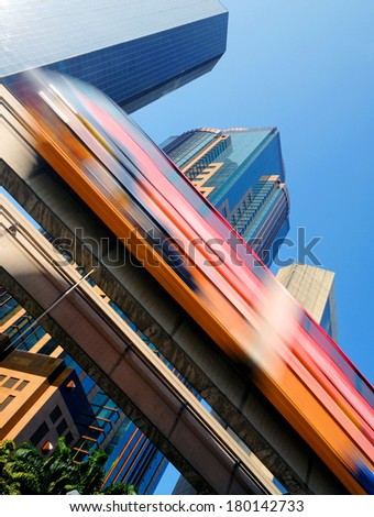 Motion Blur of a Skytrain Speeding Through a Modern Business District, Kuala Lumpur - stock photo
