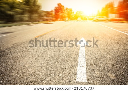 motion blur of road at sunset - stock photo