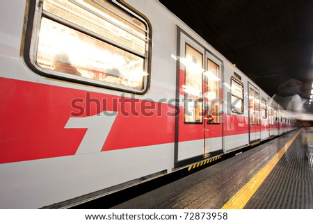 Motion Blur of Subway Train at Underground Station. - stock photo