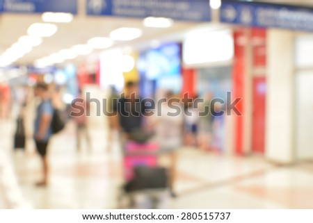 Motion blur passenger in the airport - stock photo