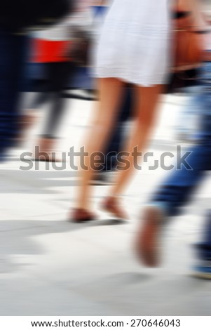 Motion blur people on street - stock photo