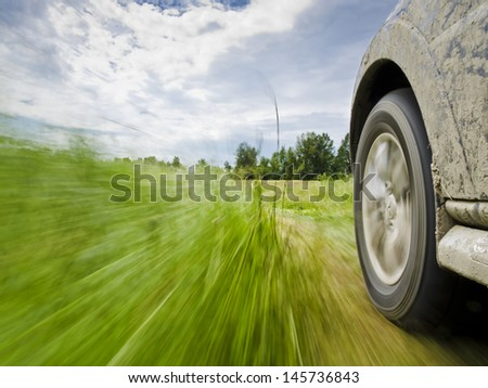 Motion blur shot of an off-road driving - stock photo