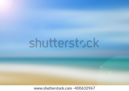 Motion blur tropical beach with sun light abstract background. Travel concept. - stock photo