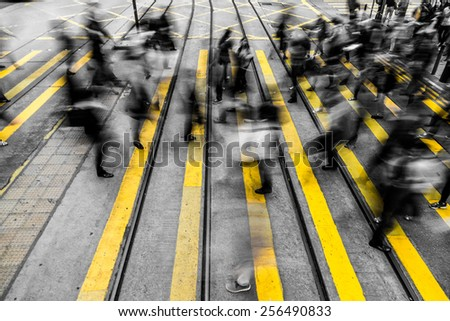 Motion blurred and color tone tuned crowded people background - take place in central district  - stock photo