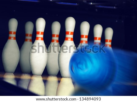 Motion blurred bowling ball on alley - stock photo