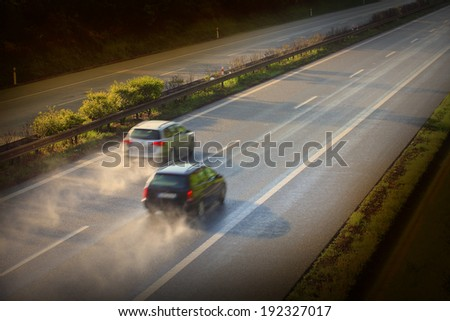 Motion blurred cars on the highway. Road safety concept. - stock photo