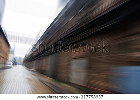 Motion blurred image of depots in industrial district - stock photo