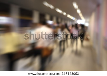 motion blurred of business people walking at the subway station - stock photo