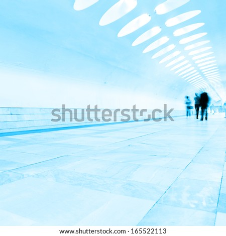 Motion blurred people at subway station. - stock photo