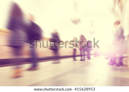 Motion blurred people waiting at subway station. - stock photo