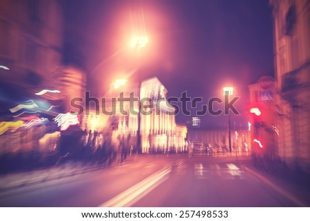 Motion blurred retro filtered city traffic lights, abstract background. - stock photo