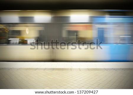 Motion blurred subway train - stock photo