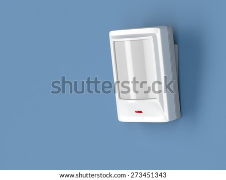 Motion detector attached on blue wall - stock photo