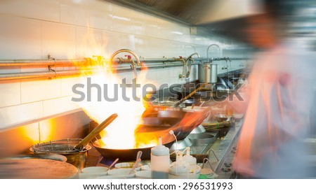 Motion fire burn is cooking on iron pan,stir fire very hot - stock photo