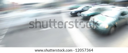 motion image of cars on city street - stock photo