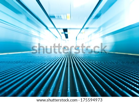 Motion of moving escalator, ground view - stock photo