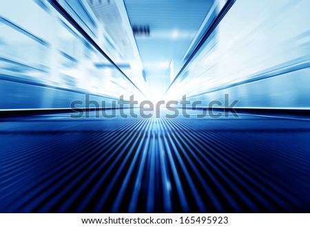 Motion of moving modern escalator way to success business - stock photo