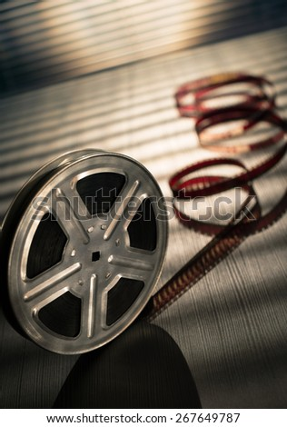 Motion picture film reel on the table - stock photo