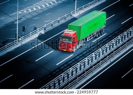 motion trucks on the freeway. - stock photo