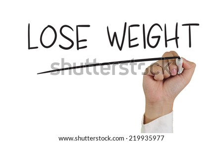 Motivational concept image of a hand holding marker and write lose weight isolated on white - stock photo