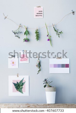 Motivational hipster mood board scandinavian  style with quotes and postcards.  Home interior decoration.  - stock photo