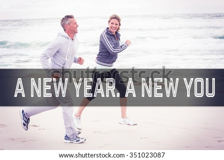 Motivational new years message against fit couple jogging together - stock photo