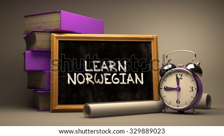 Motivational Quote. Learn Norwegian - Chalkboard with Hand Drawn Text, Stack of Books, Alarm Clock and Rolls of Paper on Blurred Background. Toned Image. - stock photo