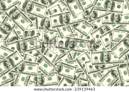 Motley background from chaotically scattered dollar banknotes. - stock photo