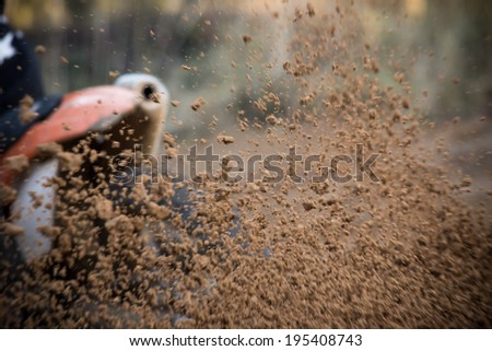 Motocross bike in a race, close-up. - stock photo