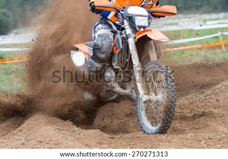 Motocross bikes street racing on the mountain - stock photo