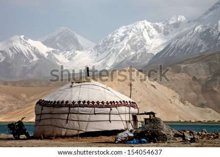 Motor Biking through Karakorum Highway Xinjian China - stock photo