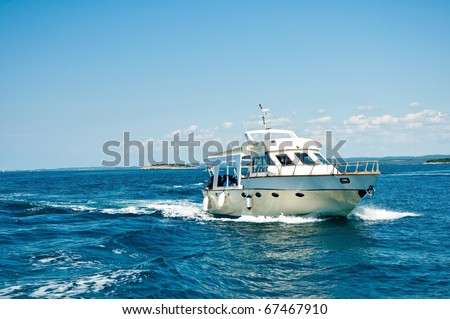 motor boat cruising the sea - stock photo